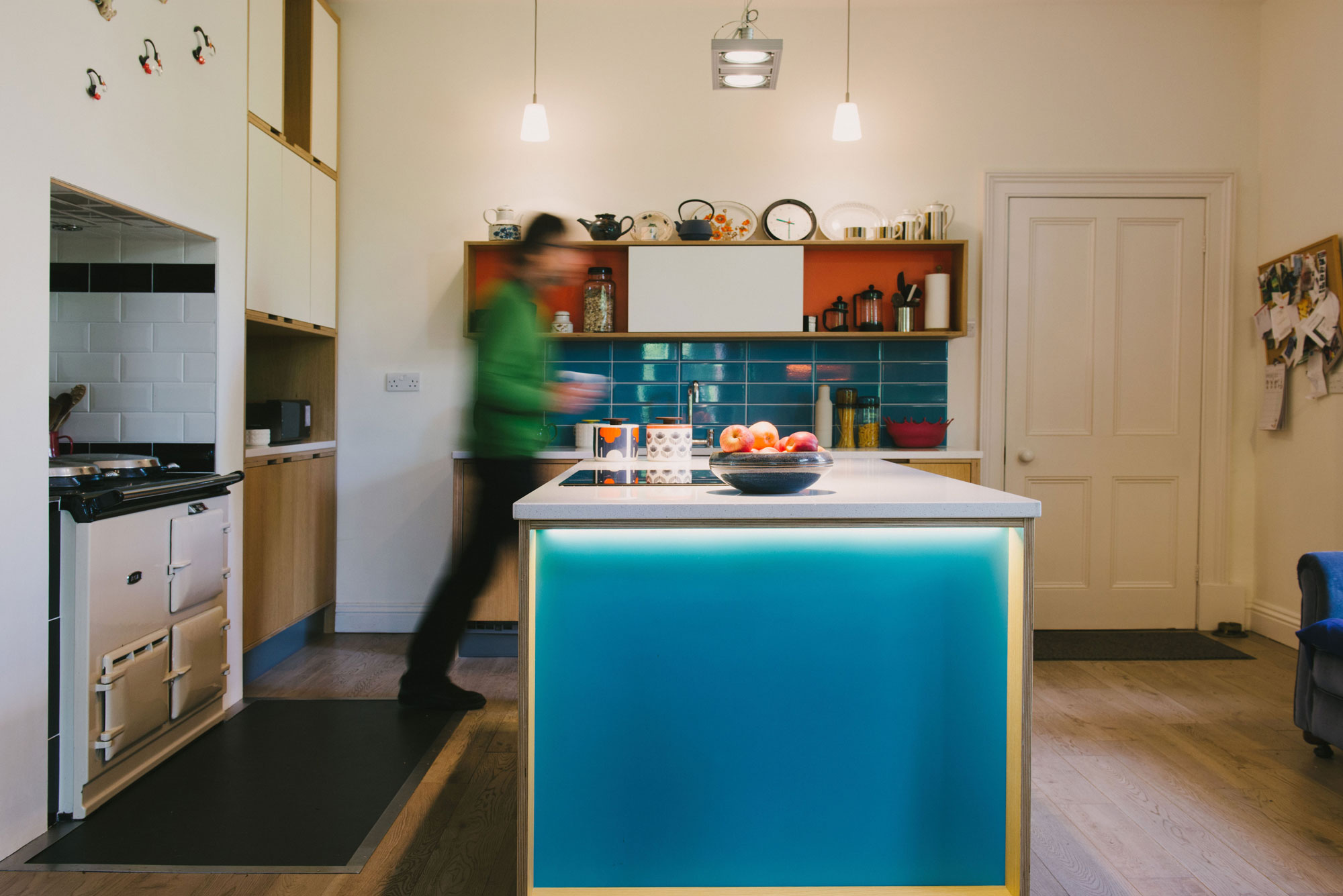blue & orange plywood kitchen