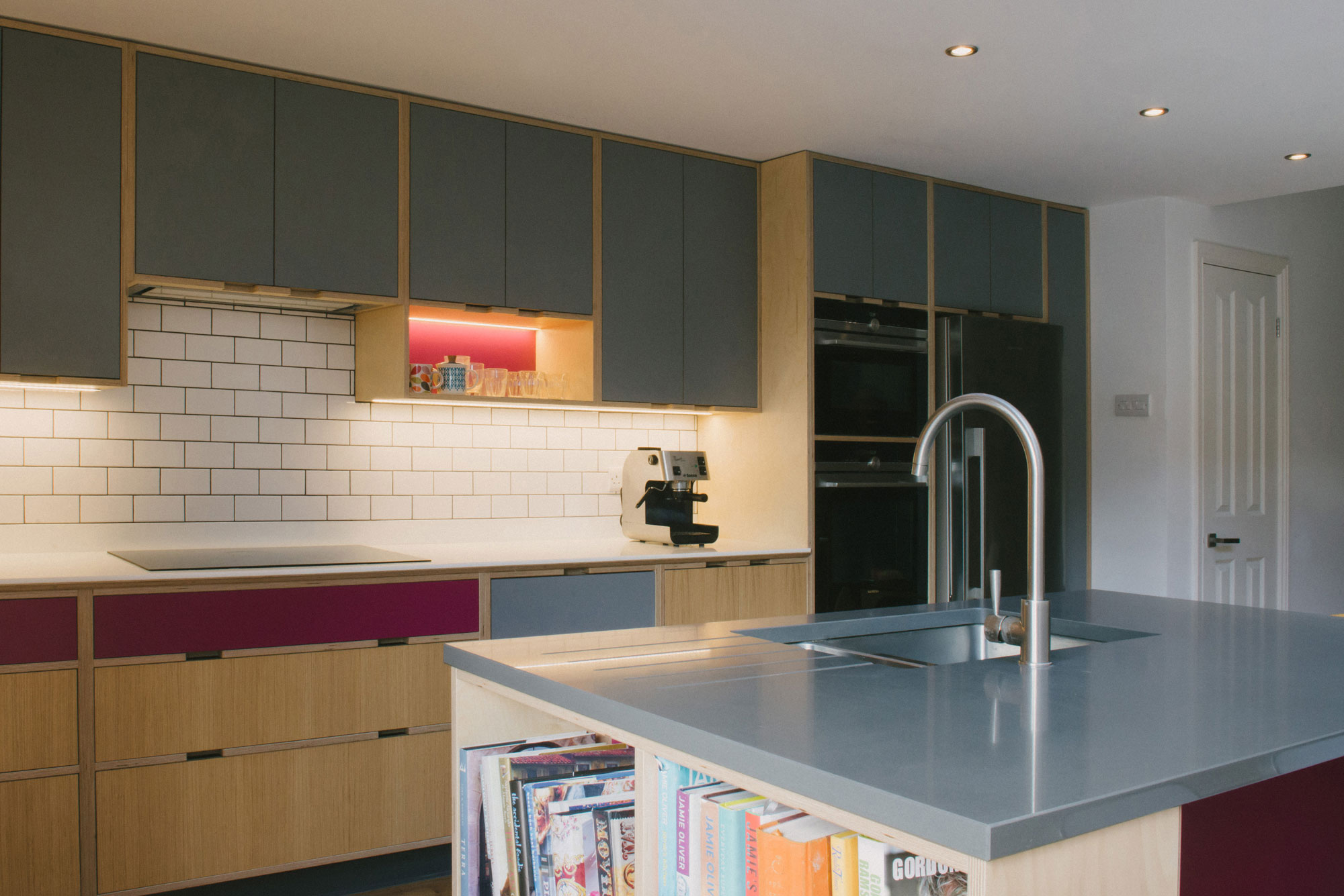 Cooking Area of Pink and Grey Plywood Kitchen