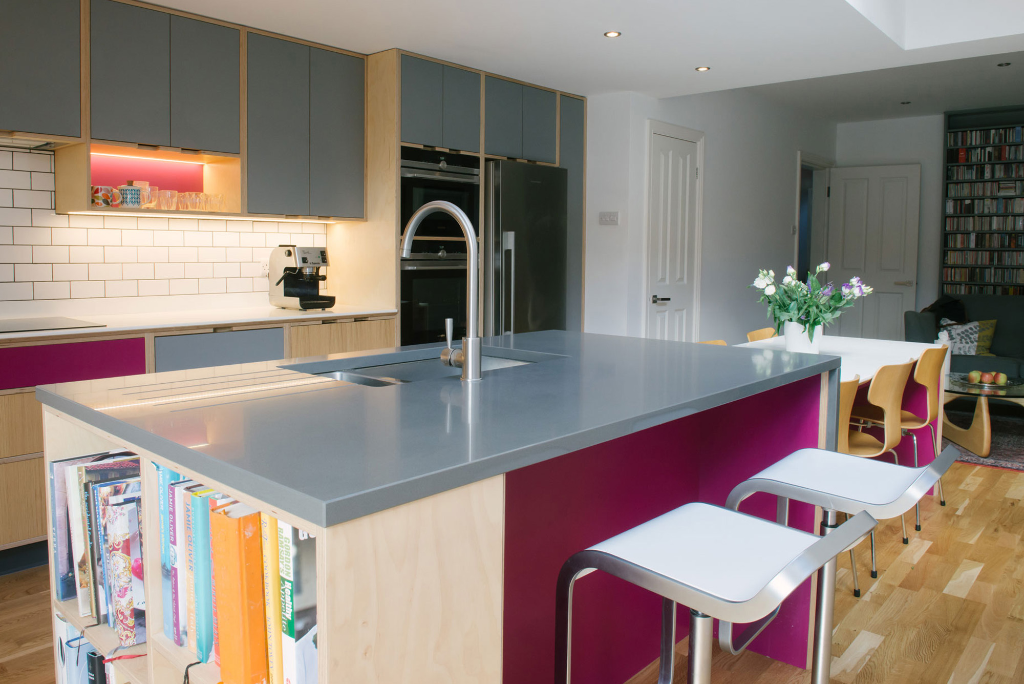Pink and grey plywood kitchen