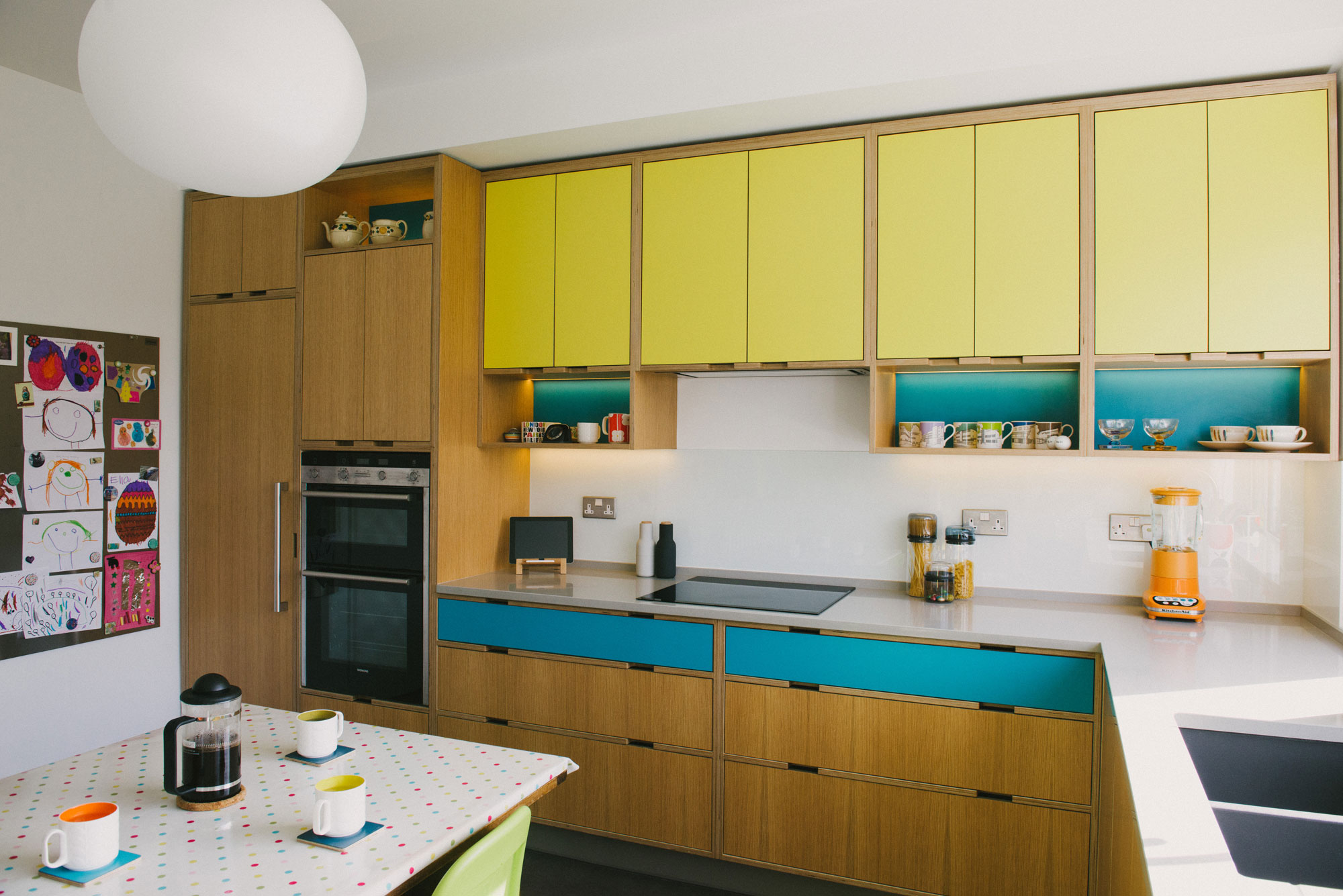 yellow and blue plywood kitchen