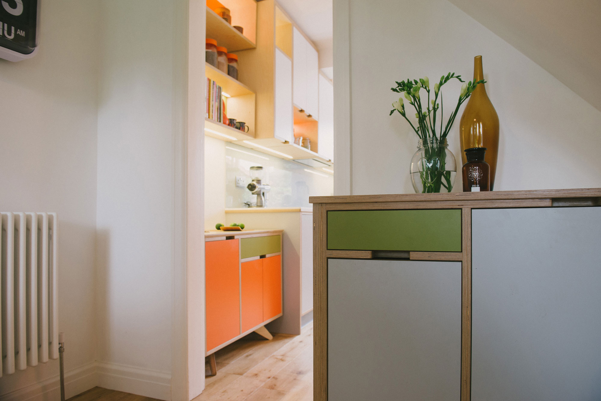 Orange & green plywood kitchen