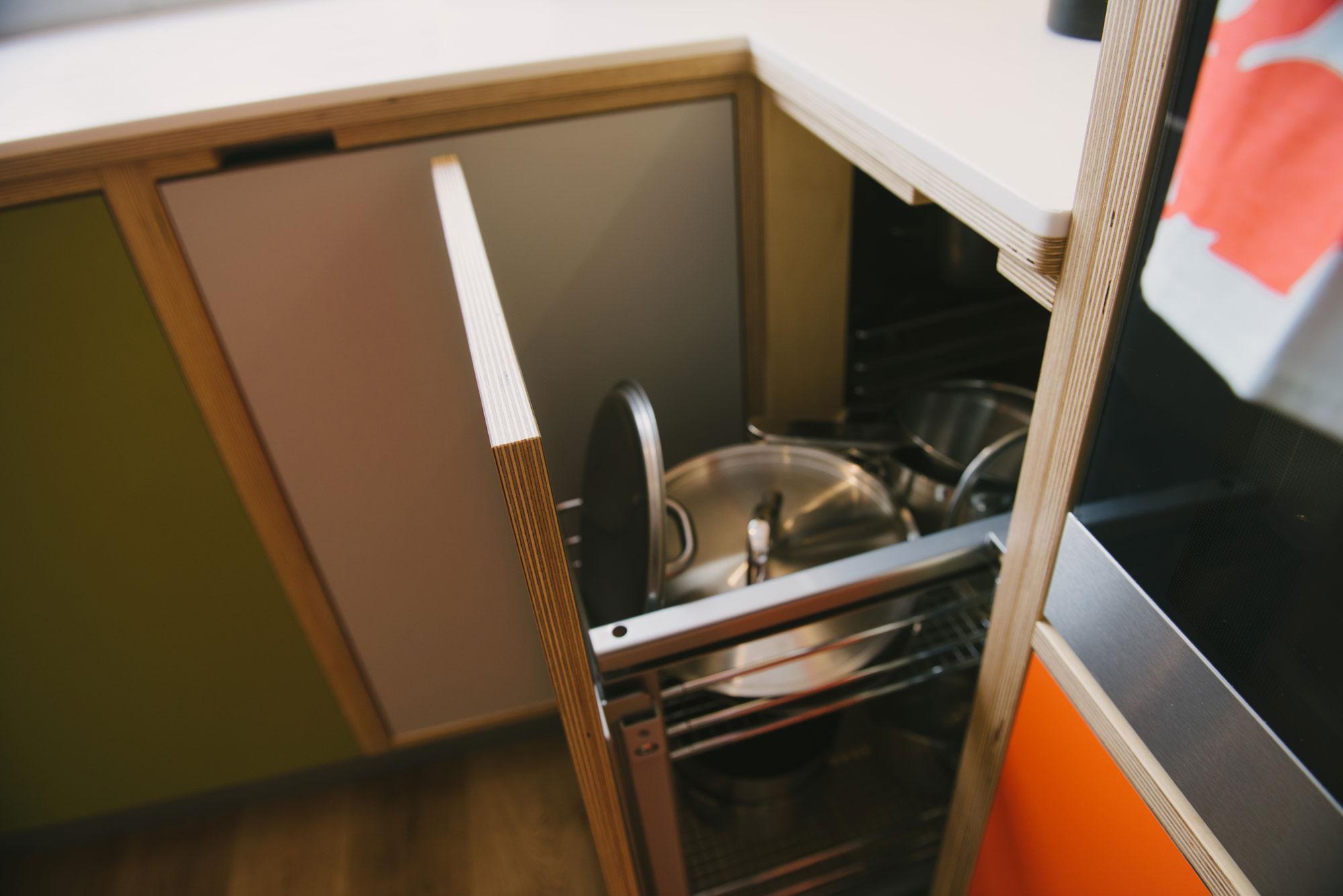 Orange and green kitchen corner cupboard