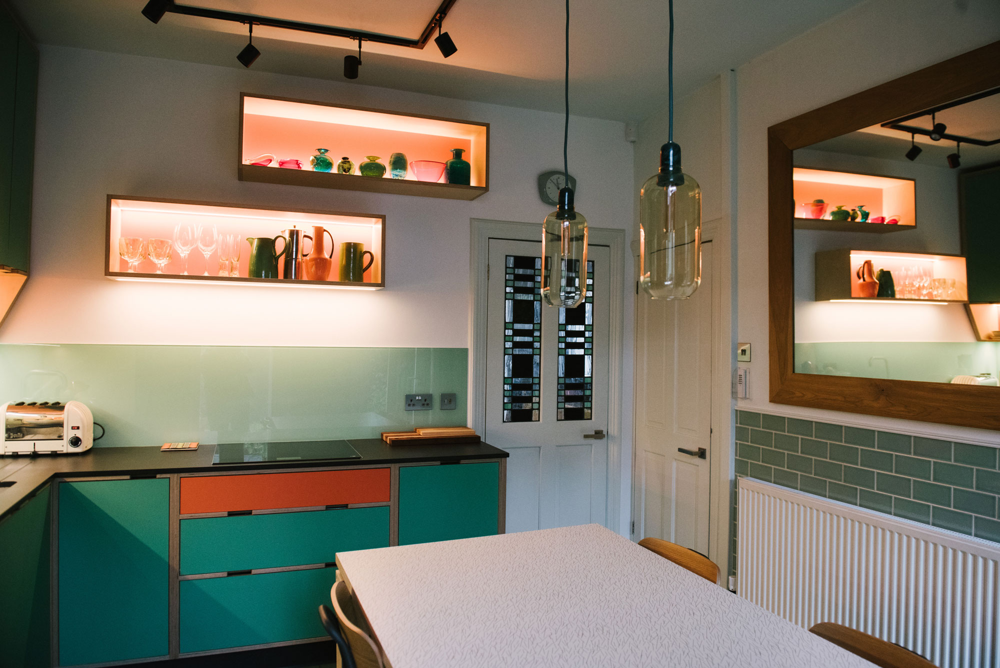 Illuminated Wall Shelving in 70's Style Plywood Kitchen