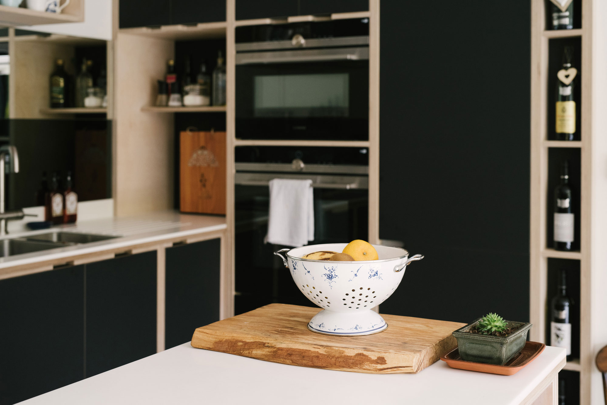 Kitchen With Mirror Splash Back - Colander of Lemons