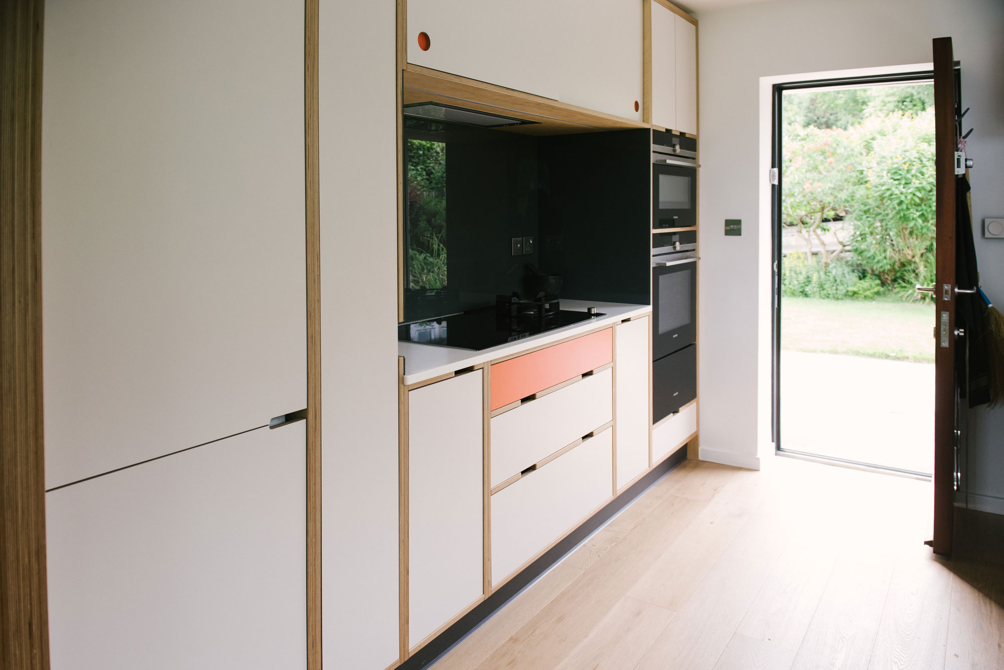 Mid Century Style Plywood Kitchen - White and Orange Kitchen