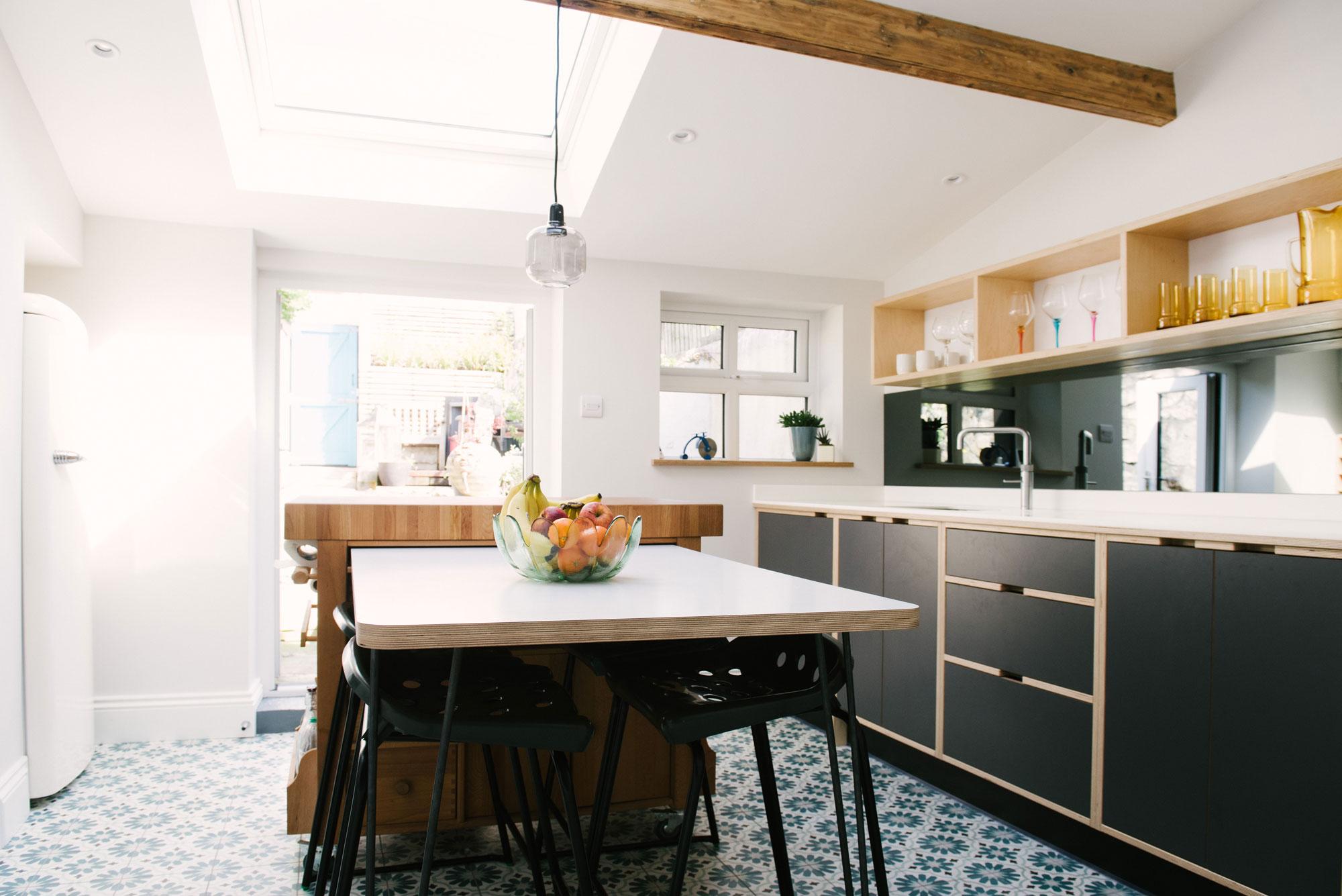 Monochrome plywood kitchen diner