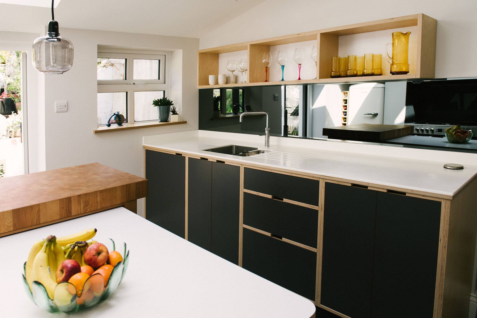 Monochrome plywood kitchen