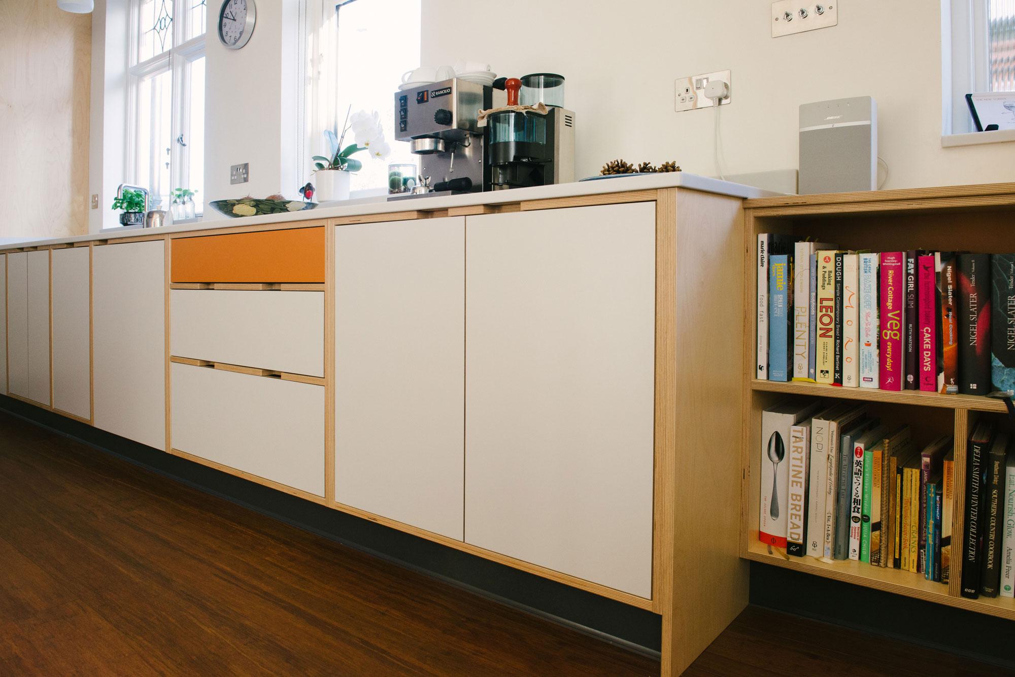 Base Units of Orange and White Laminated Plywood Kitchen