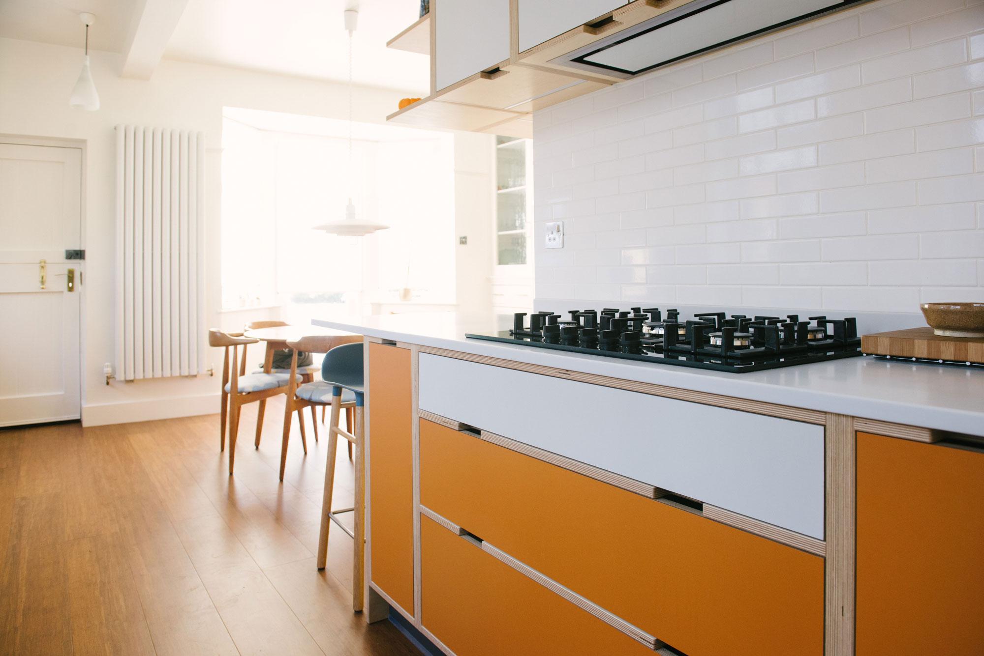 Hob in Orange and White Laminated Plywood Kitchen