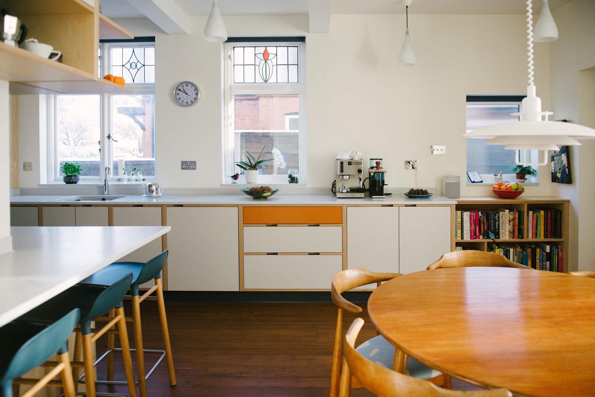 Orange and White Laminated Plywood Kitchen