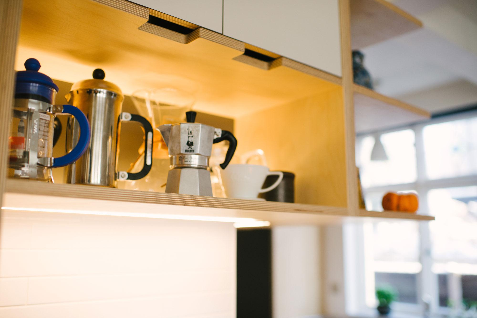 Open Shelving of Orange and White Laminated Plywood Kitchen