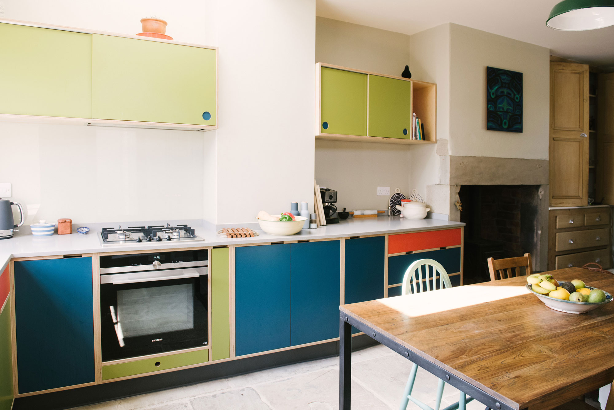 Cooking Area of Green Orange & Blue Plywood Kitchen