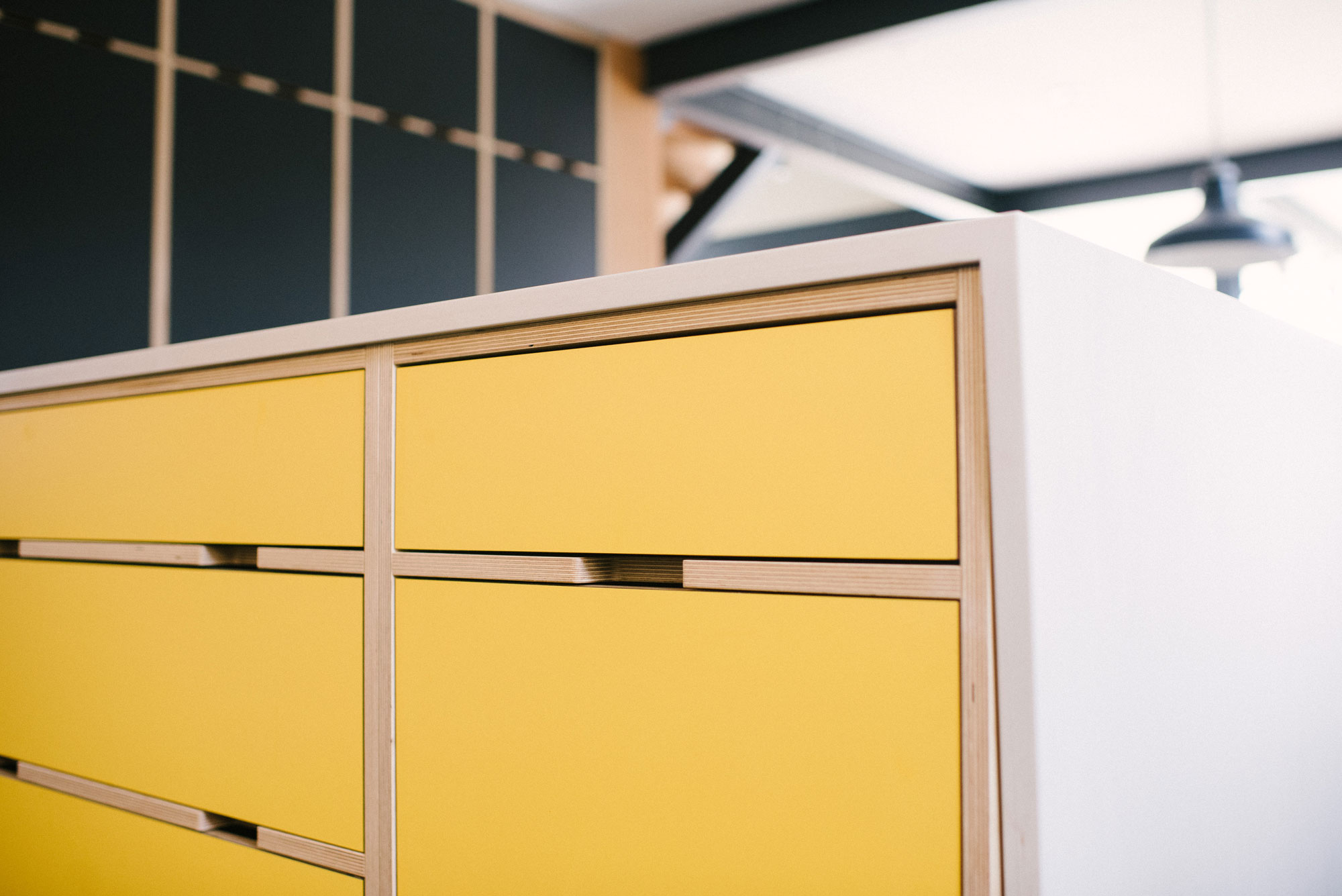 Yellow plywood kitchen drawers