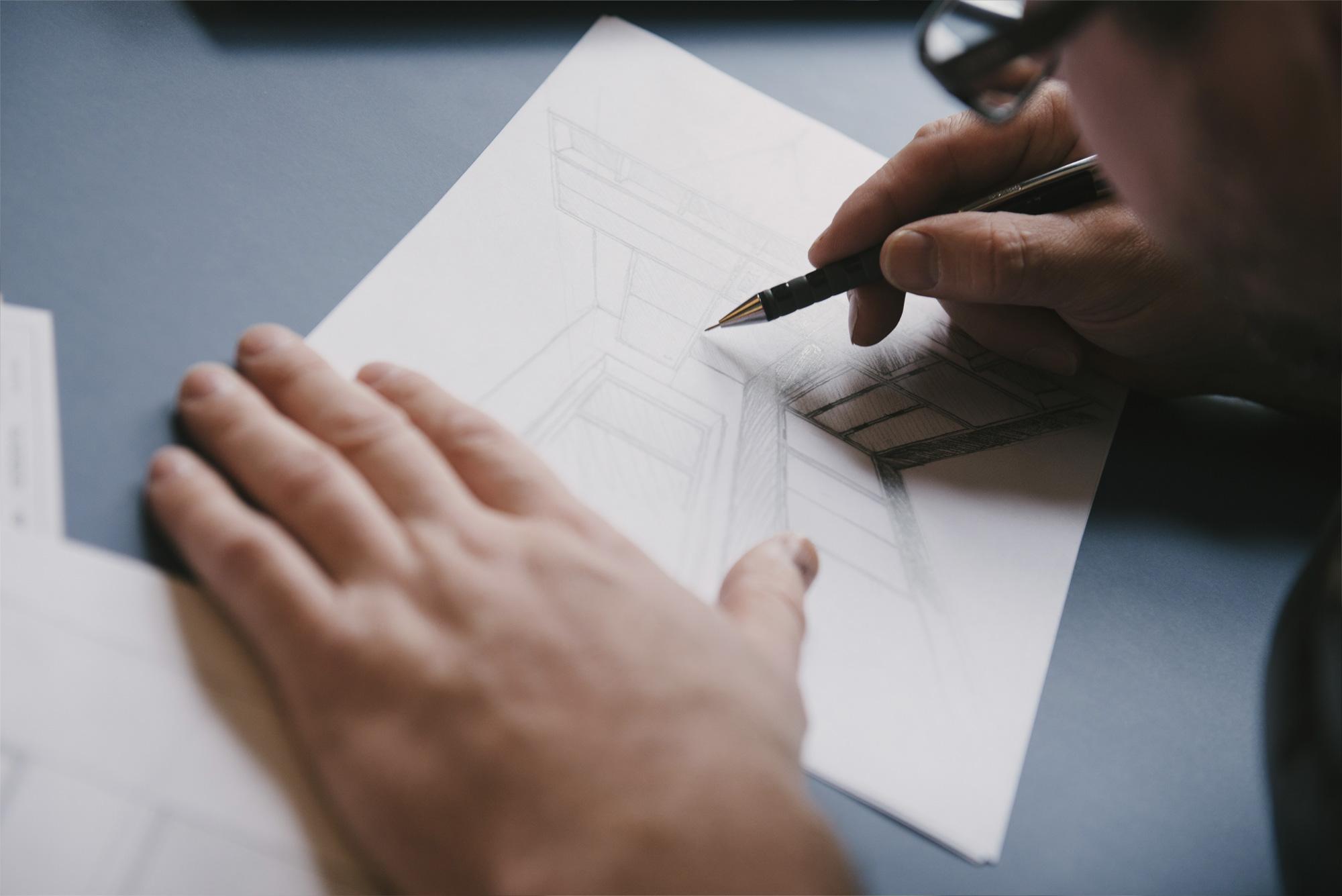 Man drawing a kitchen